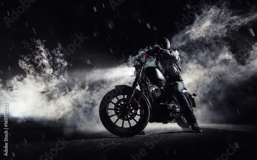 High power motorcycle chopper with man rider at night Wallpaper Mural