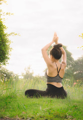 woman practicing  yoga day relax in nature , Yoga Exercise Helps the mind to concentrate, calm and shape and healthy.