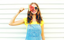 Fashion Smiling Young Woman Holding A Slice Of Watermelon In The Form Of Ice Cream Over A White Background