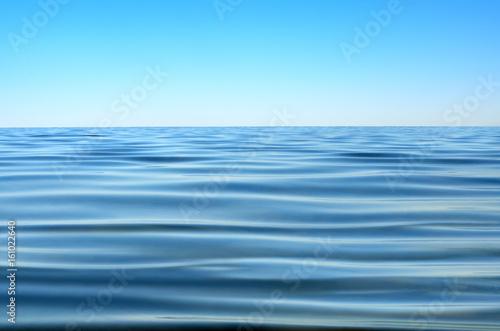 Staande foto Zee / Oceaan Panorama of sea waves against the blue sky