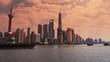 panoramic of Shanghai sunset,Lujiazui Financial Center,busy Huangpu River shipping.