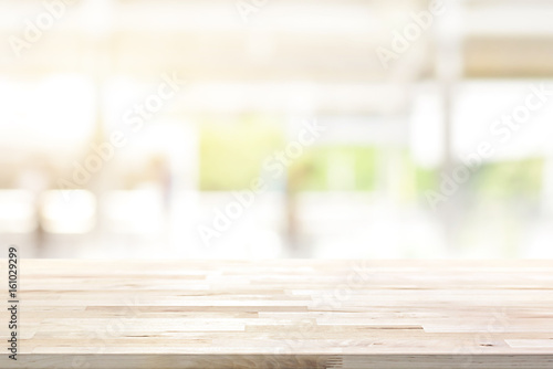 Wood table top on blur kitchen window background