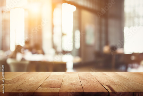 Fototapeta Wood table top on blur restaurant (cafe) interior background obraz