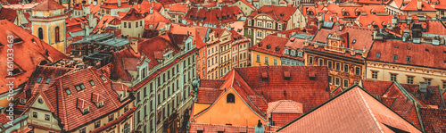 Tuinposter Oost Europa View to the colorful roofs and houses of Vysegrad in Prague, Czech Republic at autumn - aerial image, travel seasonal vintage hipster background