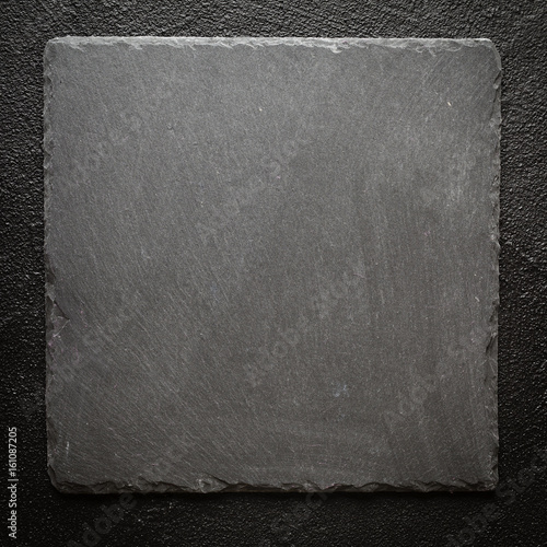 black stone plate on black surface background buy this stock photo