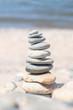 Balance stone on sea coast. Zen rocks on the beach. Feng Shui balance