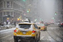 A Winter Snowstorm Brings Traffic And Pedestrians To A Slow Crawl At The Flatiron Building On Fifth Avenue.