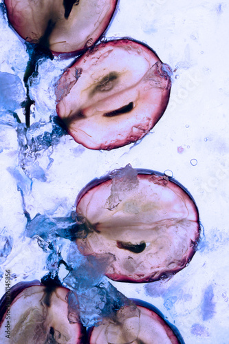 Translucent slice of red grape fruit Fototapete
