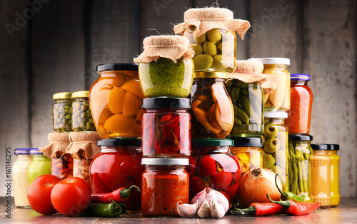 Photo  Jars with variety of pickled vegetables.