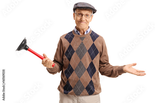 Disappointed senior holding a plunger Tablou Canvas