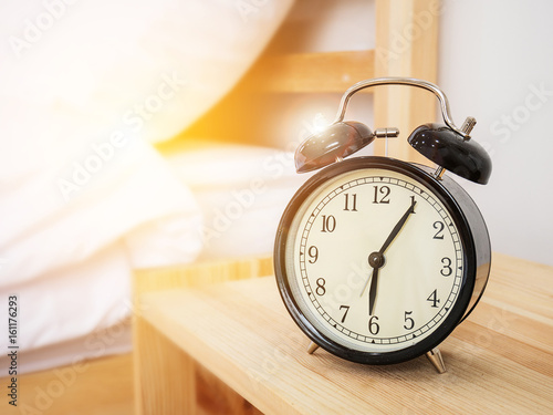 Alarm clock , wake-up time concept : Retro alarm clock with five minutes past si Wallpaper Mural