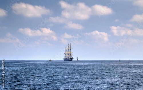 Sailing ship in the blue sea © phadventure