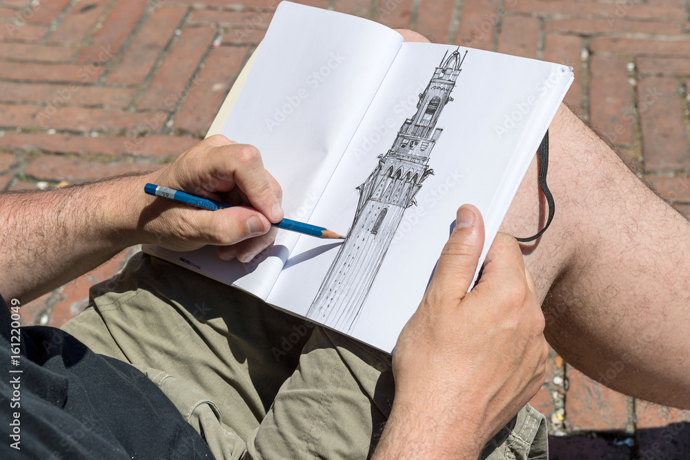 Valokuva  Talented drawer working on a painting of Torre del Mangia, Siena, Tuscany