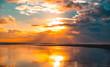 Sunset on the ocean. Cloudy sky with orange sun