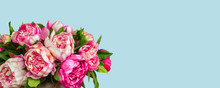 Bouquet Of Peony Flowers In Vase On Blue Background With Space For Text.