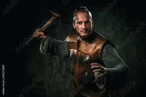 Photo  Furious viking with cold weapon