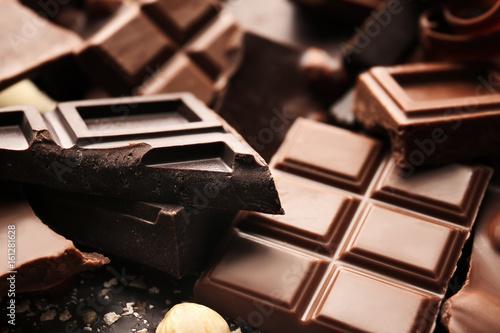 Fotografie, Obraz  Heap of broken chocolate pieces, close up