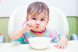 baby eating spoon