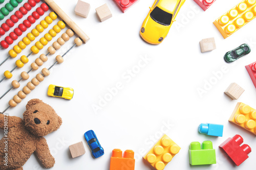 Kids toys frame on white background. Top view. Flat lay