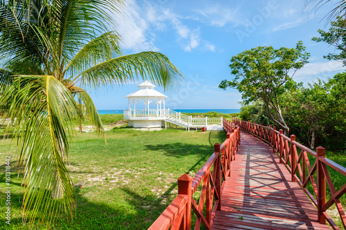 Naklejka Wooden walkway leading to the shore at Varadero beach in Cuba