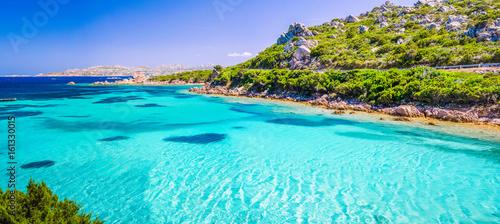 Emerald green sea water and rocks on coast of Maddalena island, Sardinia, Italy