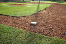Youth Baseball Infield From First Base Side In Morning Light