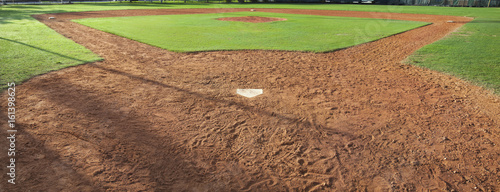 Youth baseball field viewed from behind home plate