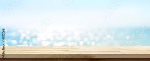 Photo  Wood table top on blue summer sparking sea water bokeh banner background