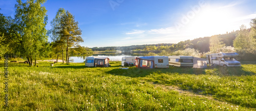 Aluminium Prints Camping Caravans and camping on the lake. Family vacation outdoors, travel concept