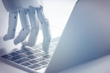 Chat Bot , Artificial Intelligence , Robo Advisor , Robotic Concept. Robot Finger Point To Laptop Button. Blue Tone.