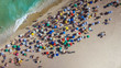 People on Ipanema Beach in Rio de Janeiro, Brazil. Top view with ocean and colorful umbrellas