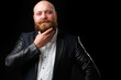 Man stroking his ginger beard