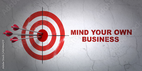 Photo  Business concept: target and Mind Your own Business on wall background