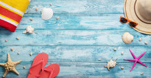 High Angle View Of Summer, Vacation, Beach Accessories On Blue Wooden Background With Copy Space