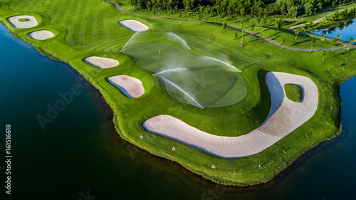 Fotografie, Tablou  Aerial view of green golf course.