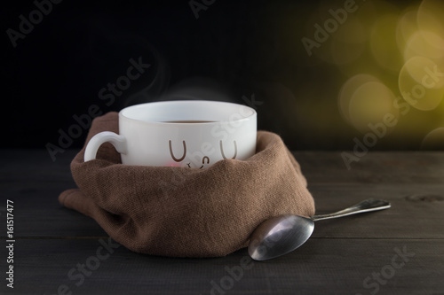 White mug of coffee with a happy smile, On bokeh background, Good night or Have a happy day concept