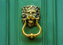 Door With Brass Knocker In The...