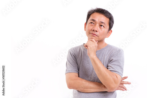 Photo  middle aged asian man thinking, studio isolated portrait