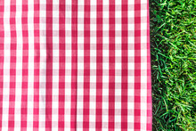 Red Gingham Tablecloth On Gree...