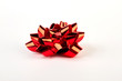 Red Christmas bow isolated. Festive bow on white background.