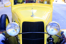 A 1930s Yellow Pickup Truck Ou...