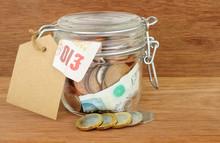 Glass Jar Filled With Cash Sav...