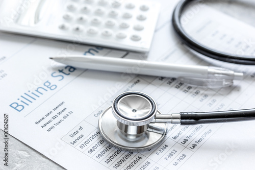 Valokuva billing statement for for medical service in doctor's office background