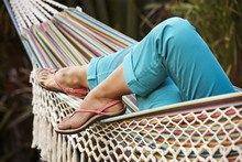 Relaxation In A Hammock In The Nature