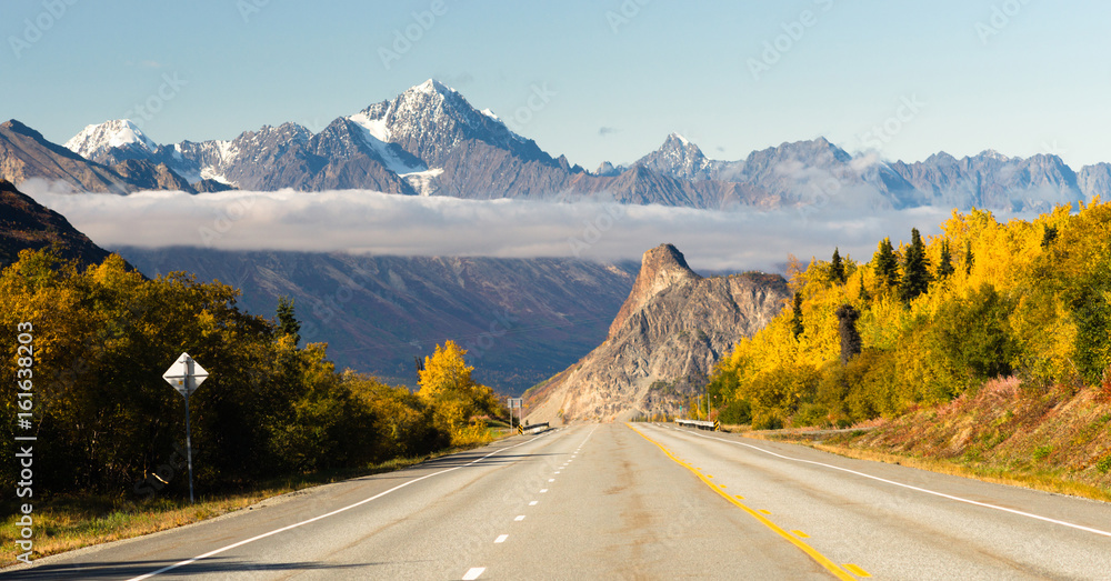 Fototapeta Road Leads Down Fall Season Open Road Alaska