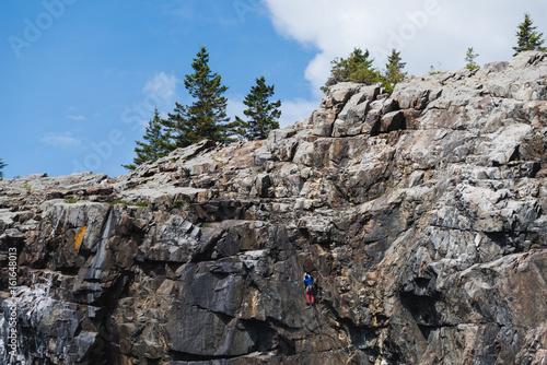 Fotografie, Obraz  Rock climbing in the Acadia National Park