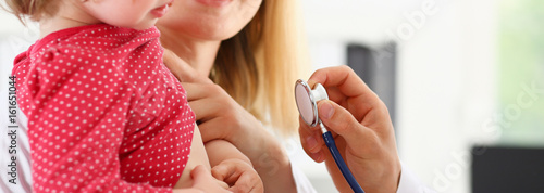 Fotografia  Little child with stethoscope at doctor reception