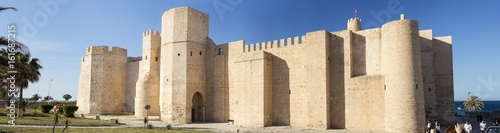 Papiers peints Fortification walls of old fort in summer day in Tunisia