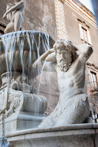 Poster de jardin Fontaine Landmarks of Catania, Sicily: closeup view of the Amenano fountain by the main Dome Square