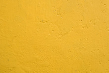 Close-up, Full Frame View A Well-done Light Yellow Wall Texture Background. Painted Cement Wall Backdrop. Design Element.